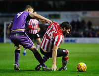 Lincoln City's Michael Bostwick vies for possession with Port Vale's Tom Pope<br /> <br /> Photographer Chris Vaughan/CameraSport<br /> <br /> The EFL Sky Bet League Two - Lincoln City v Port Vale - Tuesday 1st January 2019 - Sincil Bank - Lincoln<br /> <br /> World Copyright &copy; 2019 CameraSport. All rights reserved. 43 Linden Ave. Countesthorpe. Leicester. England. LE8 5PG - Tel: +44 (0) 116 277 4147 - admin@camerasport.com - www.camerasport.com