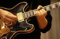 Closeup of man playing guitar. Guitar being played.