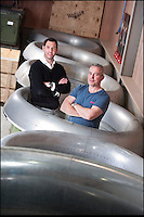 BNPS.co.uk (01202 558833)<br /> Pic: PhilYeomans/BNPS<br /> <br /> Bespoke furniture for the Jet Set.<br /> <br /> Brett and Shane Armstrong in amongst some engine intakes awaiting transformation.<br /> <br /> Two brother's have come up with ultimate in aircraft recycling - turning unwanted bits of redundant airliners into highly desirable - and highly expensive - bespoke items of furniture.<br /> <br /> Brett and Shane Armstrong from Kent scour the worlds aircraft graveyards looking for interesting items they can rescue from sad decay and with a lot of imagination and elbow grease convert into one-off gleaming items of furniture costing thousands of pounds.