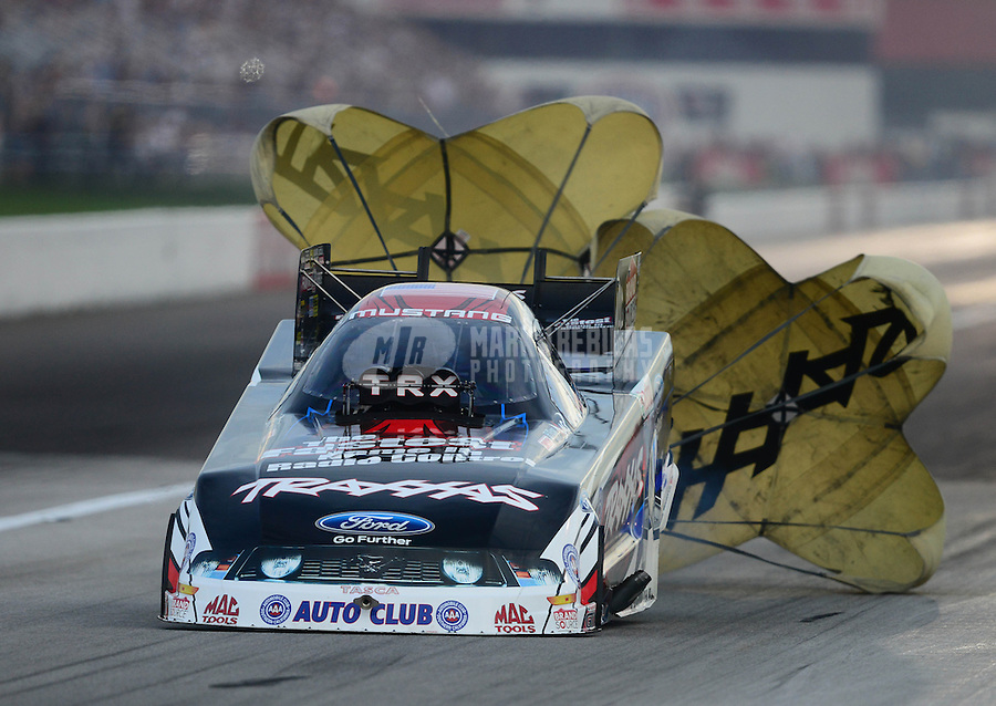 Aug. 31, 2012; Claremont, IN, USA: NHRA funny car driver Courtney Force during qualifying for the US Nationals at Lucas Oil Raceway. Mandatory Credit: Mark J. Rebilas-