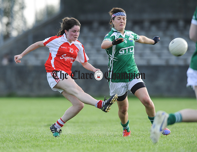 Orla Devitt of Eire Og in action against Shauna Coughlan of Kilrush during their Junior Football county final at Doonbeg. Photograph by John Kelly.