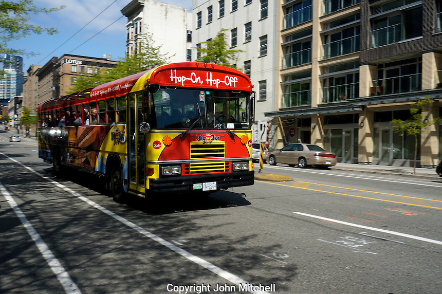 Hop-on, hop-off tour bus on Pender Street, Downtown Eastside, Vancouver, BC, Canada