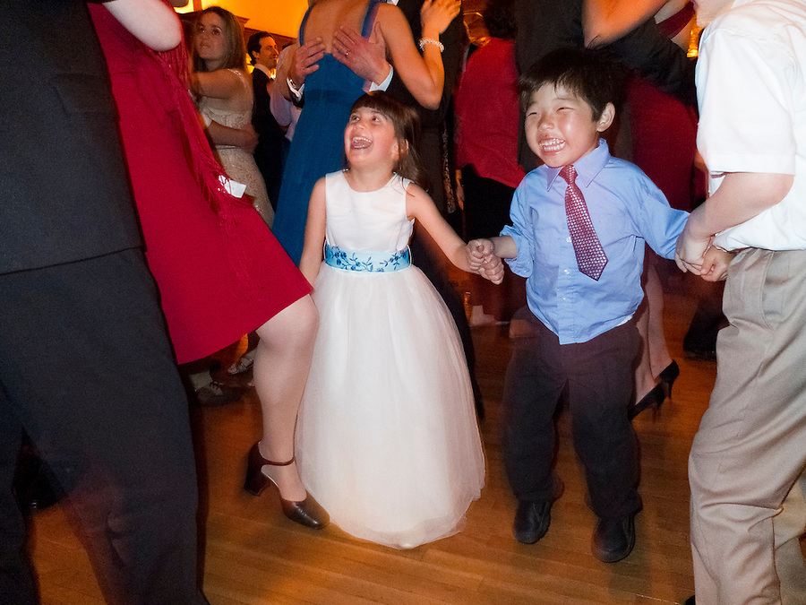 Cousins Serafina Burns and Holden Miller, 4, dance as family and friends gather to celebrate the wedding of Hannah Kurtis and Erik Tejero, and subsequent reception at the Garden House, at Look Park in Northampton, Mass., on May 12, 2012.