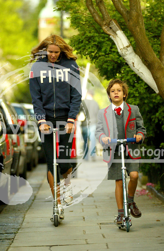 LONDON           <br /> EXCLUSIVE PICTURES BY NIGGS/EAGLEPRESS<br /> PLEASE CREDIT ALL USES<br /> ----------------------------------<br /> ELLE MCPHERSON RIDING A SCOOTER THROUGH NOTTING HILL WITH HER OLDEST SON ON THEIR WAY TO SCHOOL<br /> ----------------------------------<br /> CONTACT:  <br /> EAGLE: +44778651 4443<br /> EMAIL: photos@eaglephoto.co.uk<br /> 16 NORTH POLE ROAD<br /> LONDON W10 6QL