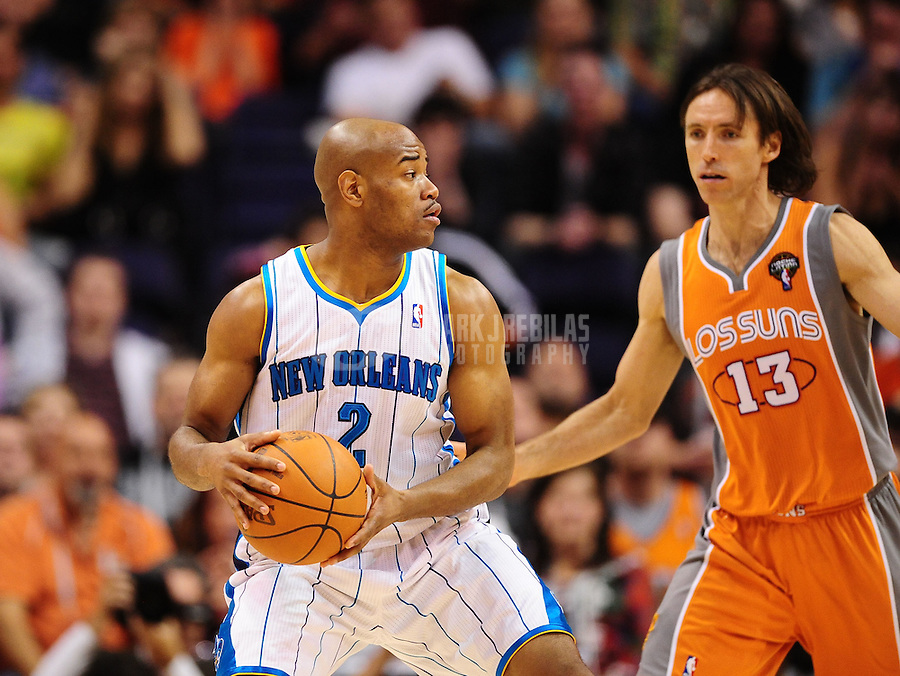 Mar. 25, 2011; Phoenix, AZ, USA; New Orleans Hornets guard (2) Jarrett Jack is defended by Phoenix Suns guard (13) Steve Nash at the US Airways Center. The Hornets defeated the Suns 106-100. Mandatory Credit: Mark J. Rebilas-