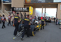Jul. 18, 2014; Morrison, CO, USA; Crew members push forward the dragster of NHRA top fuel driver Richie Crampton during qualifying for the Mile High Nationals at Bandimere Speedway. Mandatory Credit: Mark J. Rebilas-