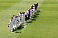 The teams and umpires observe a one minute silence in memory of the victims of the Grenfell Tower tragedy during Essex CCC vs Warwickshire CCC, Specsavers County Championship Division 1 Cricket at The Cloudfm County Ground on 19th June 2017