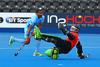 India's Akashdeep Singh beats Malaysian goalkeeper Amjad Ali but his shot is wide of the goal during the Hockey World League Semi-Final 5-8th place match between Pakistan and India at the Olympic Park, London, England on 24 June 2017. Photo by Steve McCarthy.