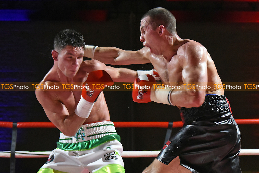 Colin Farricker (black shorts) defeats Kirk Garvey during a Boxing Show at Tolworth Recreation Centre on 9th December 2016