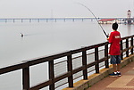 Boy fishing on the Parana River at Posadas, Misiones, Argentina.