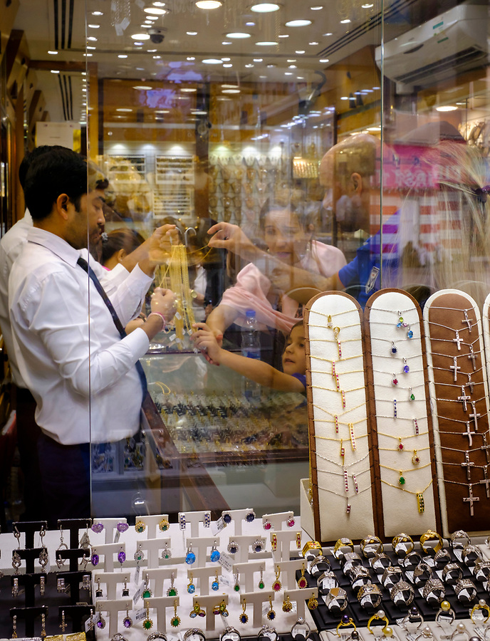 UNITED ARAB EMIRATES, DUBAI - CIRCA JANUARY 2017: Tourists shopping for jewelry at the famous Gold Souq in Dubai