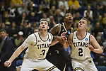 SALEM, VA - MARCH 17: Wisconsin-Oshkosh Titans guard David Vlotho (3) and Wisconsin-Oshkosh Titans guard Ben Boots (2) block out Nebraska Wesleyan Prairie Wolves forward Deion Wells-Ross (3) during the Division III Men's Basketball Championship held at the Salem Civic Center on March 17, 2018 in Salem, Virginia. Nebraska Wesleyen defeated Wisconsin-Oshkosh 78-72 for the national title. (Photo by Andres Alonso/NCAA Photos/NCAA Photos via Getty Images)