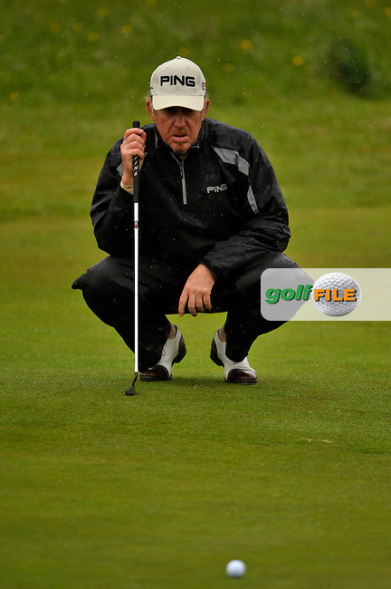 Miguel Angel Jimenez lines up his putt the 12th green during Round1 of the 3 Irish Open on 14th May 2009 (Photo by Eoin Clarke/GOLFFILE)