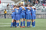 Warrior Run High School soccer players huddle up before a game.