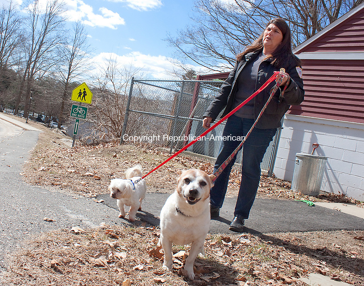 WOODBURY CT- MARCH 21 2014 032114DA08- Woodbury and Bethlehem Animal Control Officer Judy Umstead spends time with Lenny, left, a 3 year old shitzu and Henry, right, a 5 years old corgi beagle mix outside the Woodbury Dog Pound on Friday. The dogs are part of the animal cruelty case against Frederick Acker who refuses to sign over the dogs so they can find their deserving homes. The animals have been either in boarding kennels, foster homes or local pounds since November 8, 2012. Judy Umstead along with other supporters have fought back and begun a &quot;Free The 63&quot; campaign to help the dogs.<br /> Darlene Douty Republican American