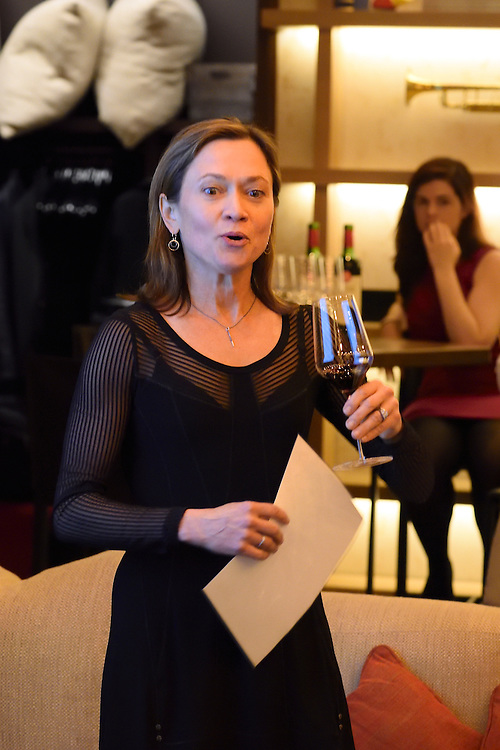Sommelier and wine expert Andrea Robinson giving a presentation on Spanish wines at a tasting event.