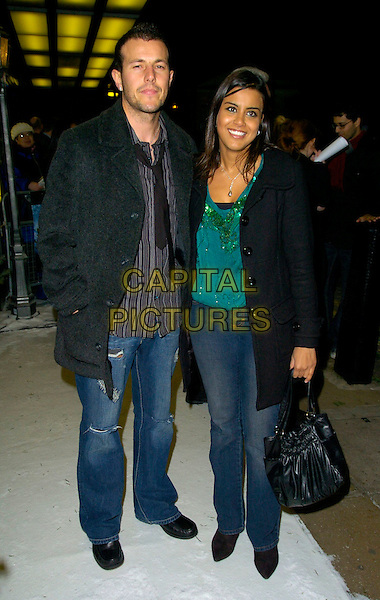 "LEE LATCHFORD EVANS & POOJAH SHAH.The ""Hogfather"" world TV premiere, Curzon Mayfair cinema, London, UK..November 27th, 2006.full length black jacket coat bag purse jeans denim.CAP/CAN.©Can Nguyen/Capital Pictures"