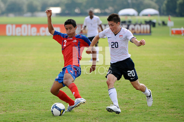 Jose Antonio Mena (2) of Costa Rica is trailed by Jorge Flores (20) of the USA. The US U-20 Men's National Team defeated the U-20 Men's National Team of Costa Rica 2-1 in an international friendly during day four of the US Soccer Development Academy  Spring Showcase in Sarasota, FL, on May 25, 2009.