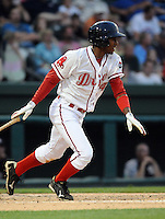 Outfielder Felix Sanchez (34) of the Greenville Drive hits during Spartanburg Night sponsored by the Greenville Drive on Wednesday, May 25, 2011, at Fluor Field at the West End in Greenville, S.C. Photo by Tom Priddy / Four Seam Images