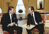 United States President Ronald Reagan meets U.S. Senate Majority Leader Howard Baker (Republican of Tennessee) in the White House in Washington, D.C. on April 23, 1981.<br /> Mandatory Credit: Bill Fitz-Patrick - White House via CNP