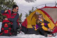 Couple camping in winter in the backcountry of the Colorado Rockies. Amy & Chad (MR 700,699). Colorado.