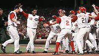 Wednesday, August 9, 2006.The Cincinnati Reds rush out to celebrate with catcher David Ross after his two run homer in the ninth inning to win the game against the St. Louis Cardinals at Great American Ballpark. Photo by The Enquirer/ Sarah Conard sc