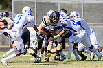 Palos Verdes, CA 09/13/13 - Reynard Saxon (Culver City #7), Rory Hubbard (Peninsula #22) and Ty'Jason Roberts (Culver City #20) in action during the Culver City vs Palos Verdes Peninsula High School Varsity Football game at Palos Verdes Peninsula HIgh School.