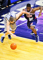 Nate Lubick of the Hoyas and Adonis Thomas of the Tigers fight for the loose ball. Georgetown defeated Memphis 70-59 at the Verizon Center in Washington, D.C. on Thursday, December 22, 2011. Alan P. Santos/DC Sports Box