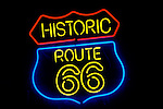 Historic Route 66 neon sign in the window of Roy's Cafe at Amboy, California