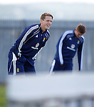 Christophe Berra having a fly scratch at his bawz