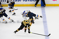 June 12, 2019: St. Louis Blues center Ivan Barbashev (49) and Boston Bruins left wing Brad Marchand (63) make contact during game 7 of the NHL Stanley Cup Finals between the St Louis Blues and the Boston Bruins held at TD Garden, in Boston, Mass.  The Saint Louis Blues defeat the Boston Bruins 4-1 in game 7 to win the 2019 Stanley Cup Championship.  Eric Canha/CSM.