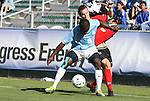 14 November 2010: UNC's Eddie Ababio (in blue) and Maryland's Jason Herrick (in red). The University of Maryland Terrapins defeated the University of North Carolina Tar Heels 1-0 at WakeMed Soccer Park in Cary, North Carolina in the ACC Men's Soccer Tournament Championship game.