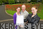 Claire Crowley (Ardfert) a student at Presentation Tralee who got 12 A's in her Junior Cert results on Wednesday she is pictured with her parents John and Phil. .