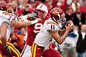 24 October 2009: Iowa State quarterback Jerome Tiller trying to elude Nebraska defensive tackle Jared Crick at Memorial Stadium, Lincoln, Nebraska. Iowa State defeats Nebraska 9 to 7.