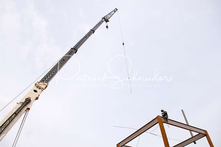 02/22/07:  A crane holds up a steel beam during expansion/construction of a Charlotte-area shopping center. Charlotte, NC, is one of the country's fastest-growing cities. ..By Patrick Schneider- Patrick Schneider Photography.