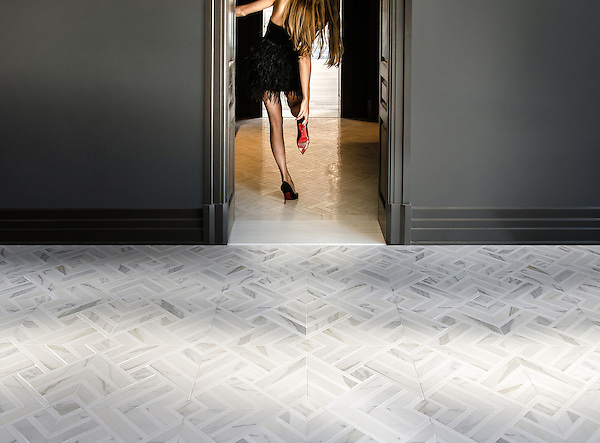 Delaunay Grand, a hand-cut stone mosaic, shown in polished Calacatta Tia and honed Thassos, is part of the Palazzo collection by New Ravenna.