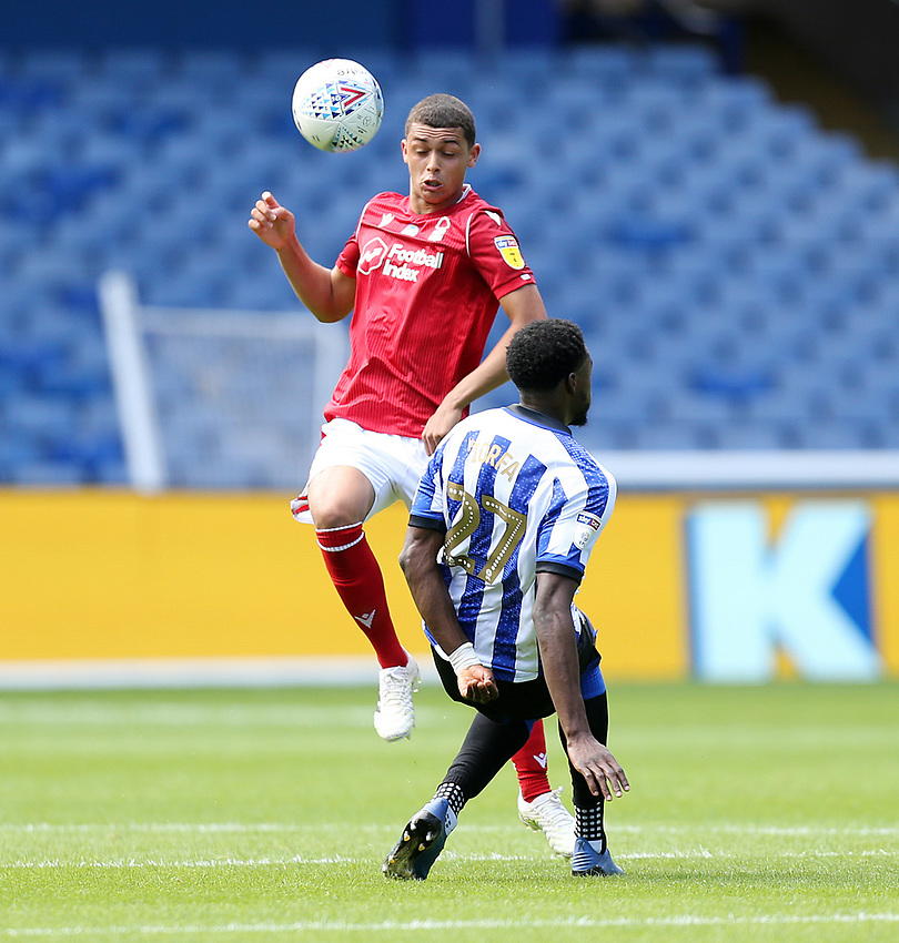 Nottingham Forest's Brennan Johnson vies for possession with Sheffield Wednesday's Dominic Iorfa <br /> <br /> Photographer Rich Linley/CameraSport<br /> <br /> The EFL Sky Bet Championship - Sheffield Wednesday v Nottingham Forest - Saturday 20th June 2020 - Hillsborough - Sheffield <br /> <br /> World Copyright © 2020 CameraSport. All rights reserved. 43 Linden Ave. Countesthorpe. Leicester. England. LE8 5PG - Tel: +44 (0) 116 277 4147 - admin@camerasport.com - www.camerasport.com