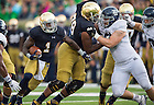 Aug. 30, 2014; Offensive lineman Ronnie Stanley (78) blocks for running back Greg Bryant (1) in the third quarter..Photo by Matt Cashore