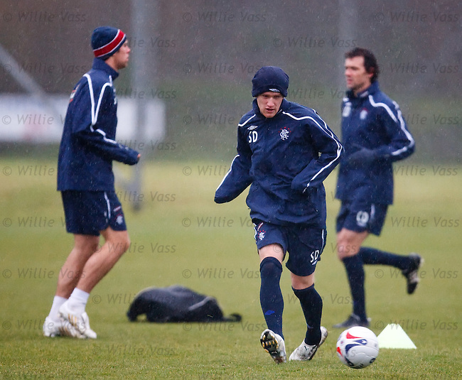 Steven Davis dribbling in the rain