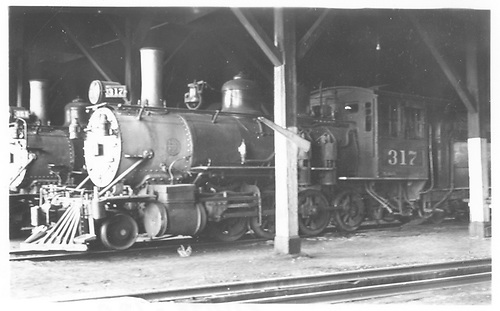 3/4 fireman's-side view of D&amp;RGW #317 in Gunnison roundhouse.<br /> D&amp;RGW  Gunnison, CO  Taken by Winters, Charles E. - 6/3/1942