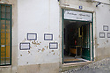 Lisbon, Portugal. 21.03.2015. Pastelaria Alfama Doce (a patisserie) in a typical narrow street in the Alfama district of Lisbon. © Jane Hobson.
