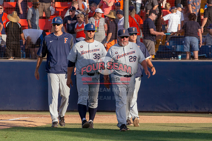 Cal State Fullerton Titans coaches Rick Vanderhook, Chad Baum, Steve Rousey, and Neil Walton after winning Game 2 of the Super Regionals at Goodwin Field on June 09, 2018 in Fullerton, California. The Cal State Fullerton Titans defeated the University of Washington Huskies 5-2. (Donn Parris/Four Seam Images)