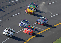 Apr 29, 2007; Talladega, AL, USA; Fans throw bottles and cans at Nascar Nextel Cup Series driver Jeff Gordon (24) as he heads towards the checkered flag under caution to win the Aarons 499 at Talladega Superspeedway. Mandatory Credit: Mark J. Rebilas