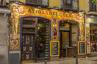 Gloriously decorated restaurant front beckons hungry travelers inside to enjoy the unique tastes of Madrid.