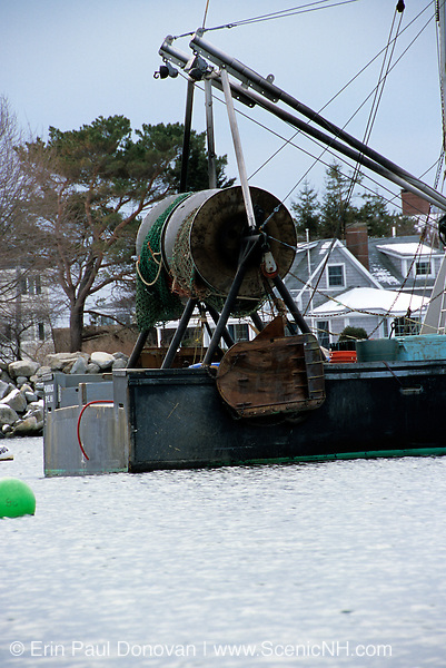 The beautiful scenic landscape of New Hampshire 's shoreline which is part of the New England USA seacoast. A lobster / Fishing boat in Rye Harbor