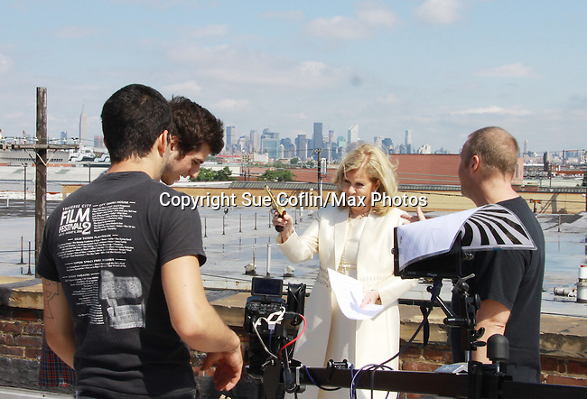 Director Fritz Brekeller with Guiding Light Tina Sloan who stars in Empire The Series as it films on set June 3, 2012  in Brooklyn, New York. (Photo by Sue Coflin/Max Photos)