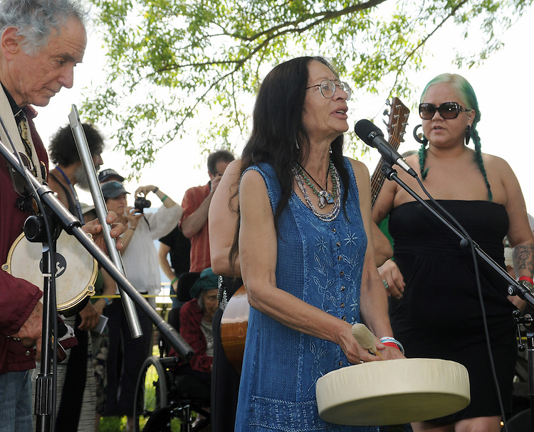 Margo Thunderbird, delivering a message in song, at the Blessing of the River Ceremony, held along the bank of the Hudson River, on the first day of the Clearwater's Great Hudson River Revival Festival 2013, held at Croton Point Park, in Croton-on-Hudson, NY, June 15, 2013. Photo by Jim Peppler. Copyright Jim Peppler 2013 all rights reserved.