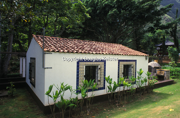 """Portuguese House Heritage Park, Iao Valley, Maui, Hawaii<br /><br />Kepaniwai Heritage Gardens<br /><br /><br /><br />'Iao Valley Road <br />(Highway 32), <br />Wailuku <br />Central Maui<br /><br />Once a bloody battle site where Maui warrior corpses, victims of Kamehameha I, blocked the 'Iao Stream, the name means """"damning of the waters"""". Now the realization of architect Richard Tongg's dream, this lovely garden features a variety"""