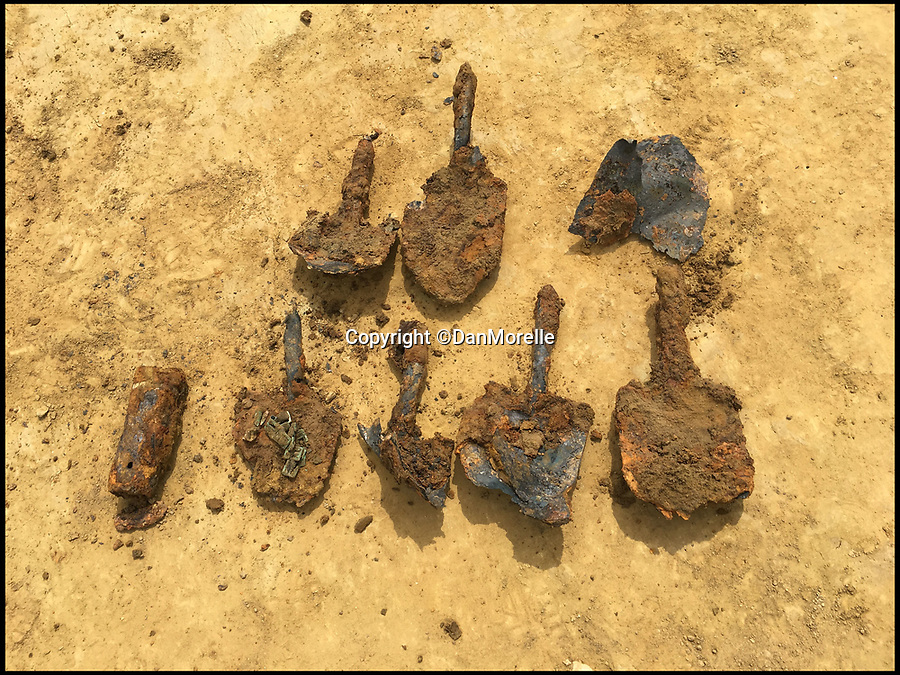 BNPS.co.uk (01202 558833)Pic: DanMorelle/BNPS<br /> <br /> ***Online Embargo 13/7/18**<br /> <br /> British shovels.<br /> <br /> Some 125 First World War soldiers have been discovered entombed in an perfectly preserved German trench system 101 years after they were killed.<br /> <br /> Most of the men, who are German, British, French and South African, were found where they fell during some of the most ferocious fighting of the war.<br /> <br /> Other skeletal remains were located buried in a mass grave alongside religious artefacts placed there by their comrades. <br /> <br /> The 'hell on earth' discovery was made by archaeologists ahead of a housing development on a small field in Flanders, Belgium.