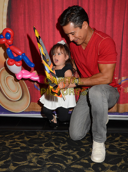 Mario Lopez &amp; daughter Gia Francesca Lopez<br /> Red carpet premiere of Ringling Bros. and Barnum &amp; Bailey Present &quot;Built to Amaze&quot; at The Staples Center in Los Angeles, CA, USA, <br /> 11th July 2013.<br /> full length family child kid father dad red t-shirt kneeling bending down <br /> CAP/ADM/BT<br /> &copy;Birdie Thompson/AdMedia/Capital Pictures